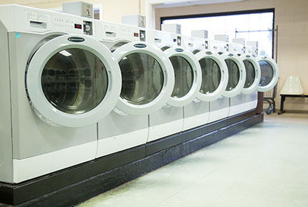 A row of white washing machines